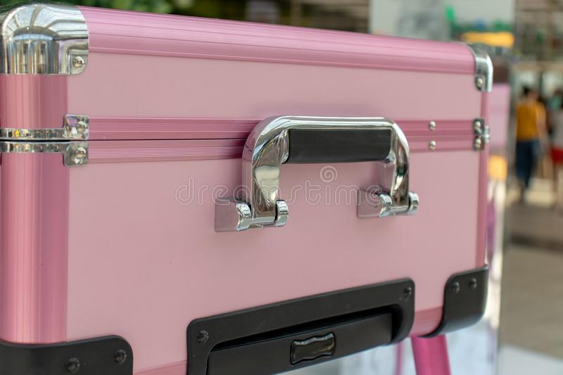 Pink shiny glamour beauty case with chrome handle. Beauty, make-up and fashion concept. stock photos