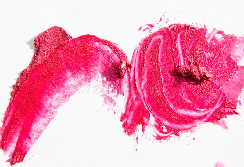 Pink shiny lipstick stroke with mother of pearl isolated on white background.  royalty free stock photos