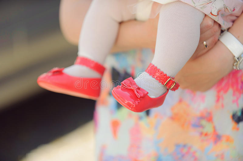 Pink Shoes. Girl's feet in pink shoes with bow stock photography