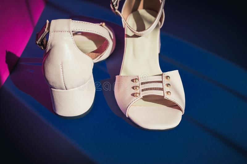 Pink shoes with small heel on dark background stock photos