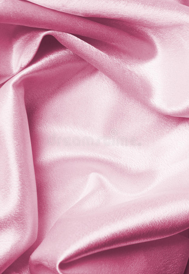 Pink silk. Pastel pink silk fabric folded, good for background royalty free stock photography