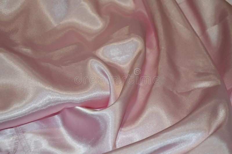 Pink silk background. Textile satin royalty free stock photography