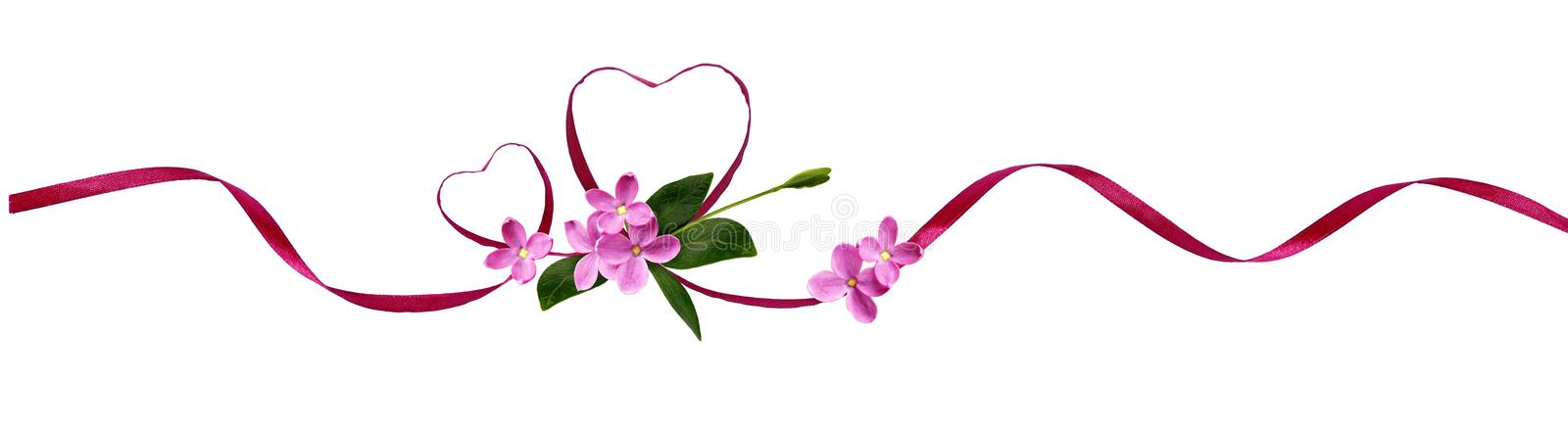 Pink silk ribbon hearts and small flowers for Valentine`s day. Isolated on white stock photos