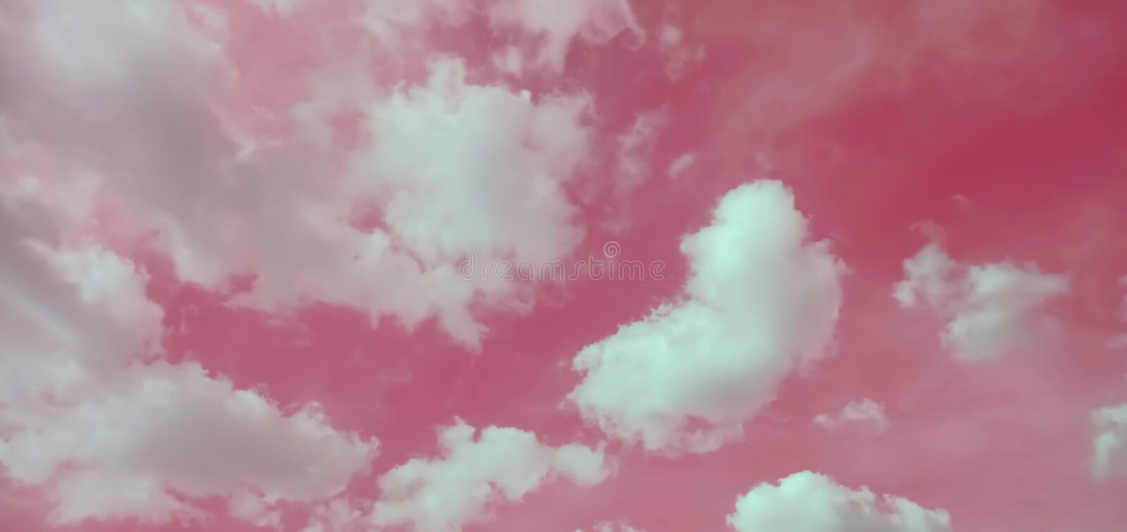Pink sky and beautiful white clouds stock images