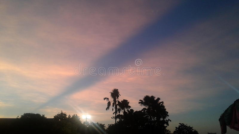 Pink sky with blue sky stock images