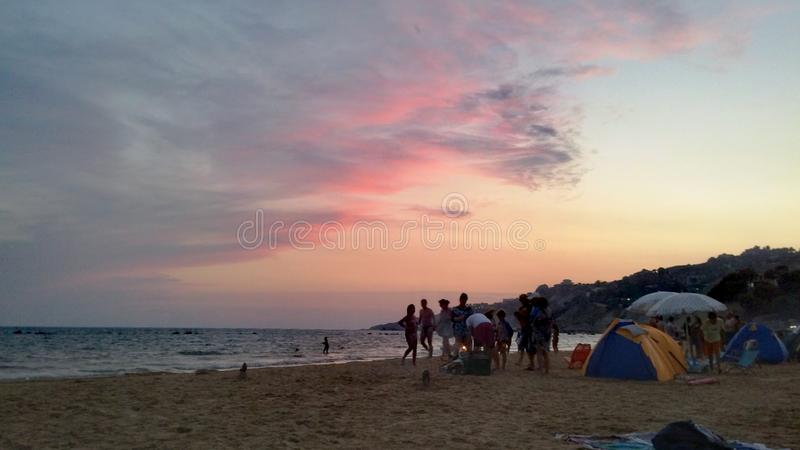 Sky and clouds in the sea. Pink sky and clouds under sea stock photo