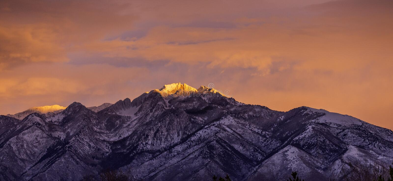 Pink Sky And Light On Mountain. Pink Sky showing on Lone Peak Mountain at sunset stock photos