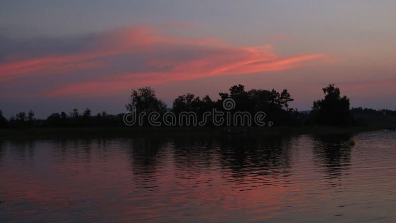 Pink sky over lake Pfaffikon royalty free stock images