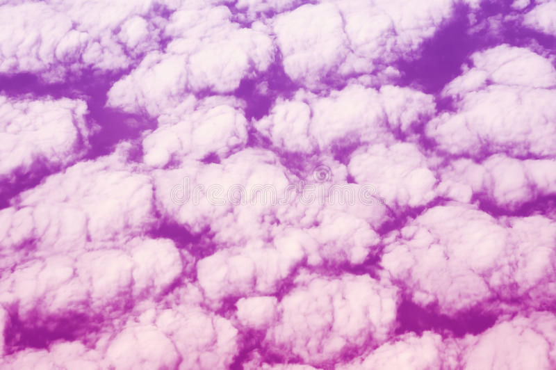 Pink sky and puffy clouds stock images