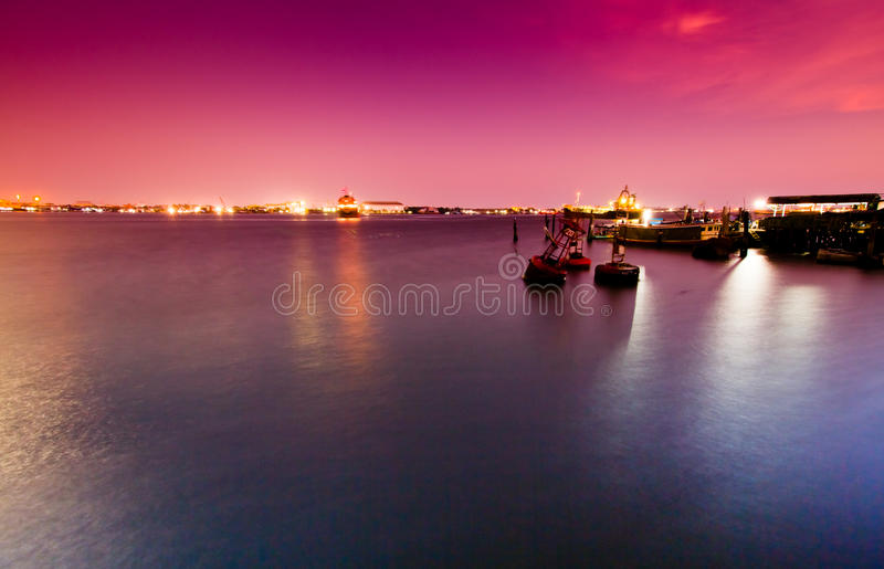 Pink sky sea port royalty free stock photos