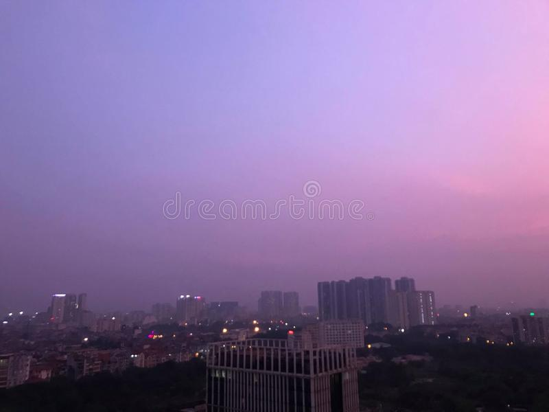 Pink sky sunset in Vietnam. Beautiful sunset with pink purple sky city view in Hanoi, Vietnam royalty free stock photography
