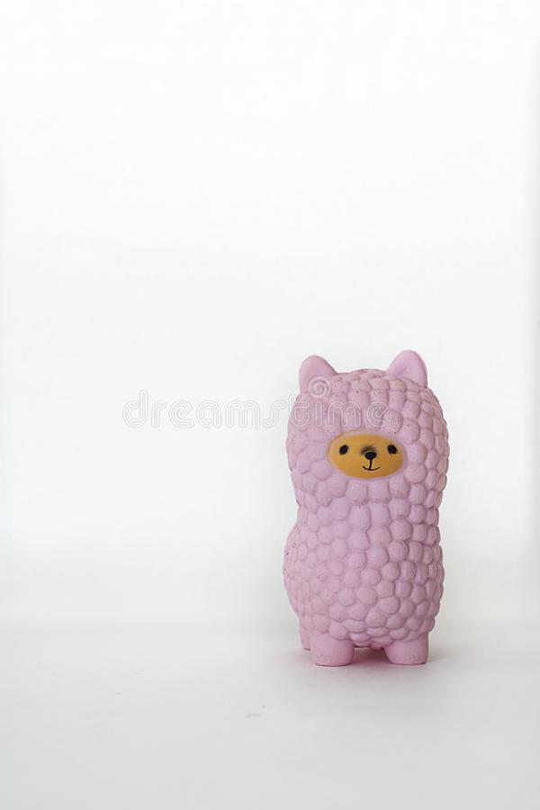 Pink small llama squishy on white empty background. Vertical with copy space. Isolate. Soft toy for kids, antistress. Pink small llama squishy on white empty royalty free stock photos