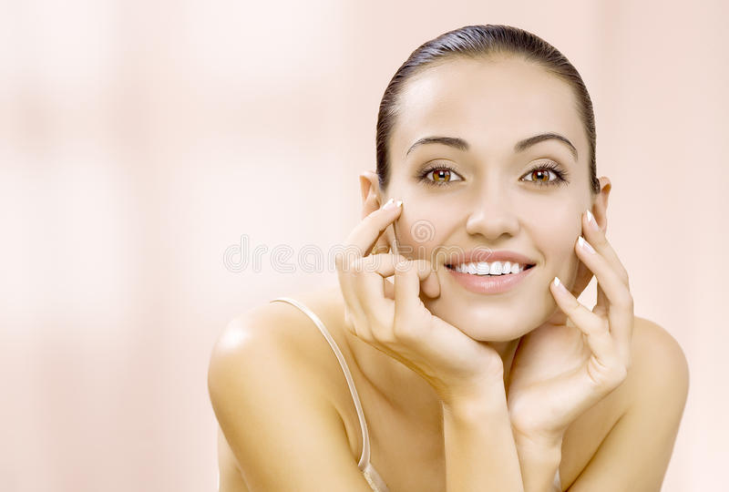 Pink smile. Portrait of nice young gorgeous woman on pink back royalty free stock photography