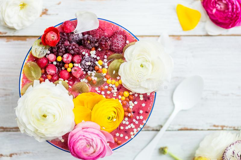 Pink Smoothie from Banana and Forest Berries in the Bowl with Ra royalty free stock photos