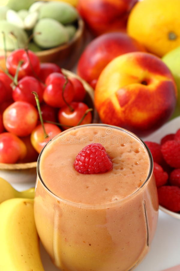 Pink smoothie with ingredients royalty free stock photos
