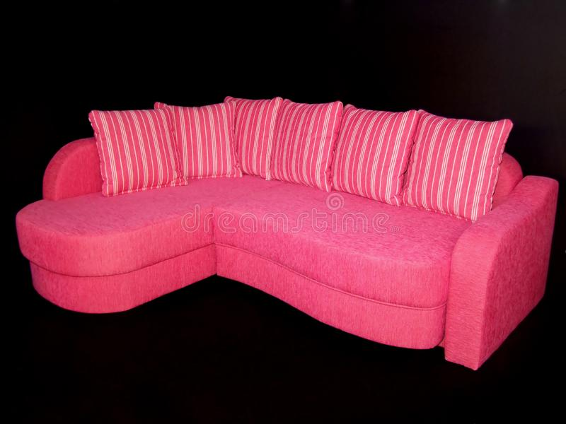 Pink sofa stock images