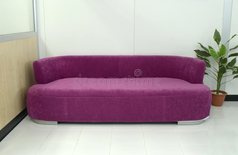Pink sofa. Pink large moedern sofa in the room stock photography