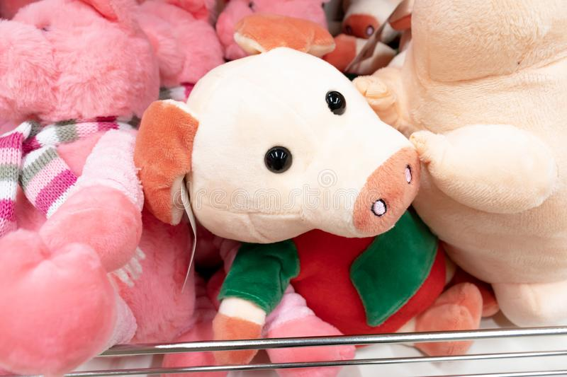 Pink soft toy pig close up in the toy store as a symbol of chinese new year.  stock photo