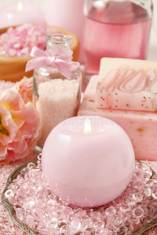 Pink spa set: scented candle, bath caviar, bar of soap and liquid soap stock photo