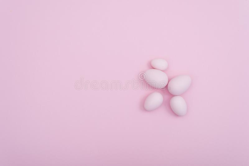 Pink Spreaded Easter eggs on pink background. Creative design stock photo