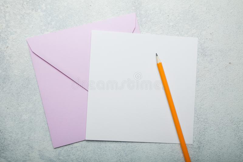 Pink square envelope and blank greeting card on vintage white background royalty free stock photography
