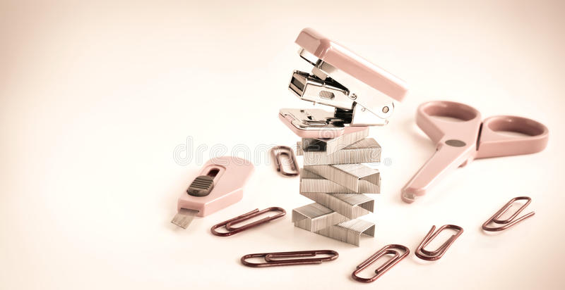 Pink stapler with office accessories
