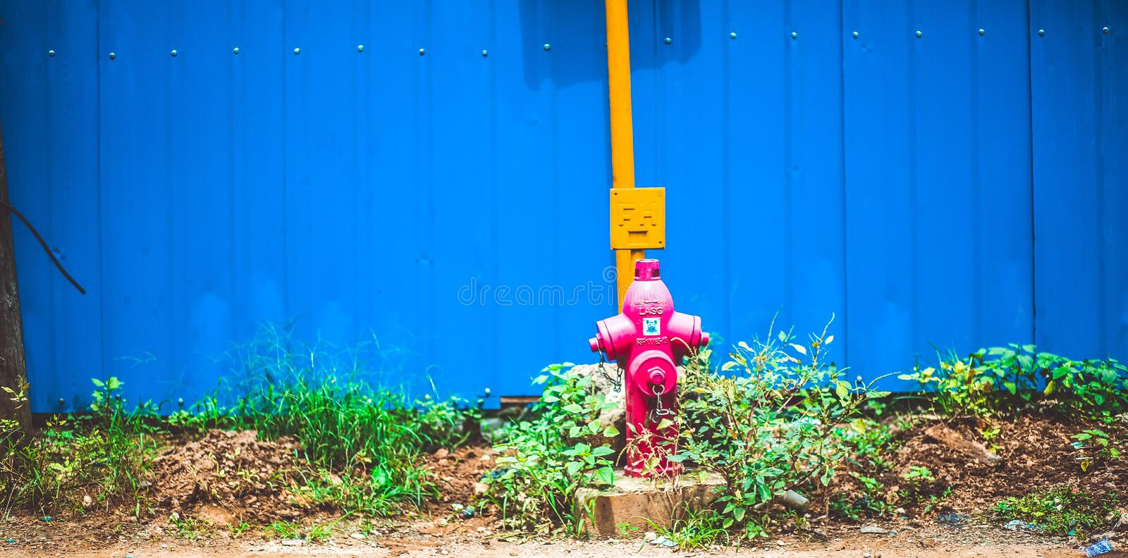 Pink Steel Water Pump Behind Blue Fence Free Public Domain Cc0 Image