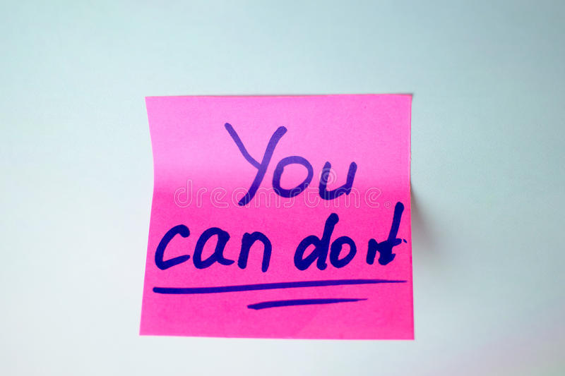 Pink sticker that says you can do it on a blue background stock image