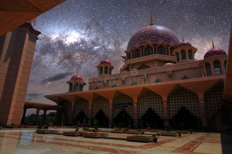 Pink stonned mosque. Putra Jaya mosque inner court and its pink color dome under a moon light shadow and milky way light stock image