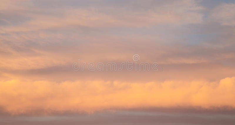 Pink Storm Clouds in Layers of Lines at Sunset stock images