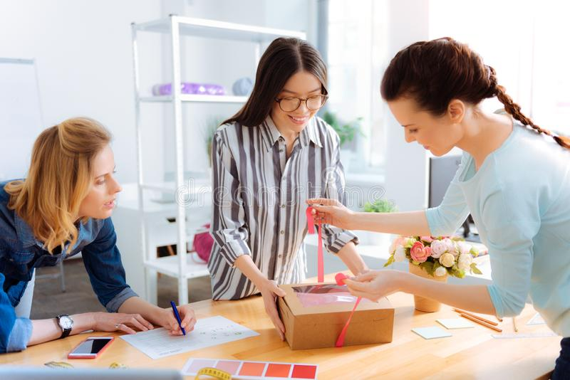 Amazing brunette helping her colleague royalty free stock photo