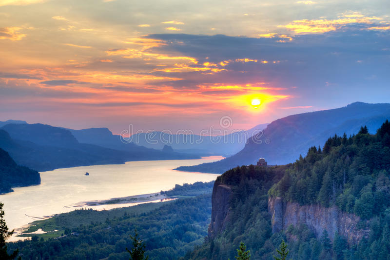 Pink Sunrise over the Columbia River Gorge. Crown Point and Vista House with rising sun over Columbia River Gorge royalty free stock photos