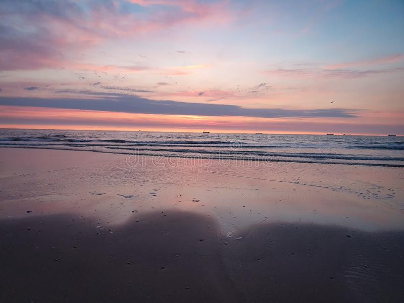 Pink sunset on beach royalty free stock image