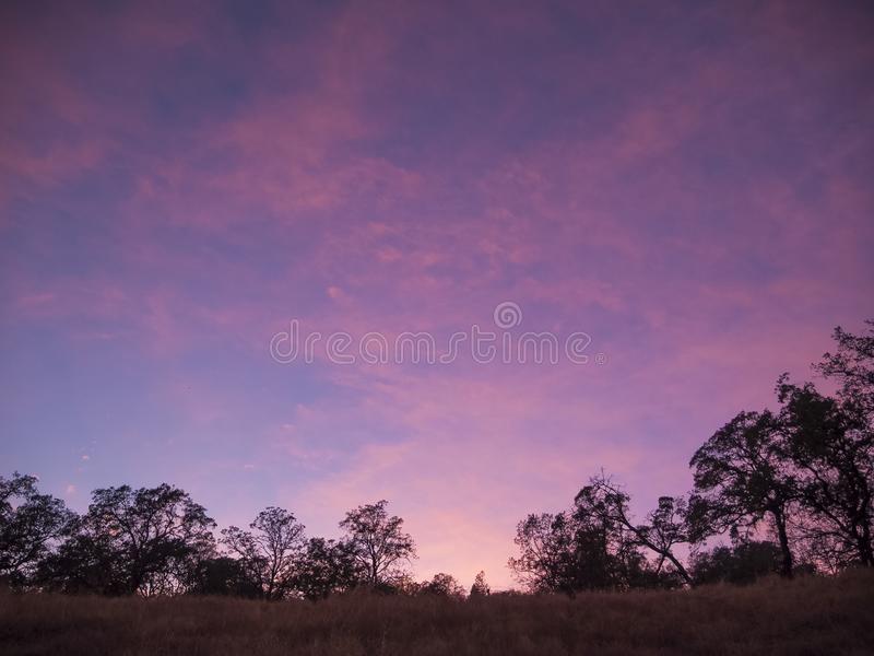 Pink Sunset in California. Pink sunset over the hills of El Dorado Hills, California. Cloudy skies make the best sunsets royalty free stock image