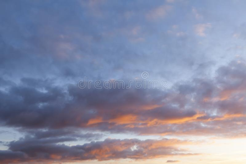 Pink sunset cloudy sky 0596. Pink sunset sky with beautiful clouds. Nature cloudscape background royalty free stock photo