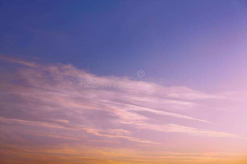 Pink sunset or dawn. There is a bright photo of a pink sunset or dawn. Luminous clouds in the rays of the setting sun. Contrails of planes in the evening sky royalty free stock photos