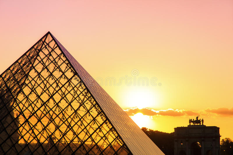 Pink sunset Louvre royalty free stock image