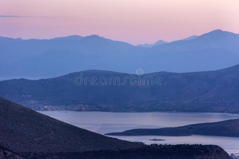 Pink sunset over mountains, Delphi, Greece stock images
