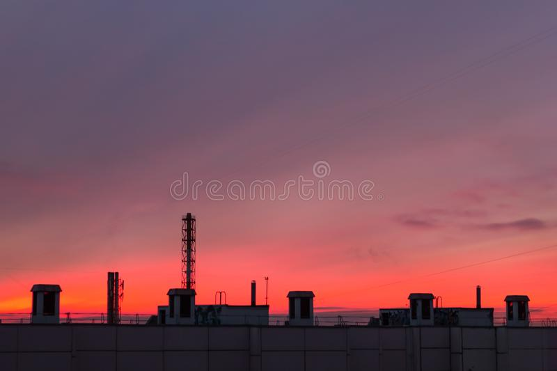 Pink sunset over the rooftops of the city. urban evening building royalty free stock image