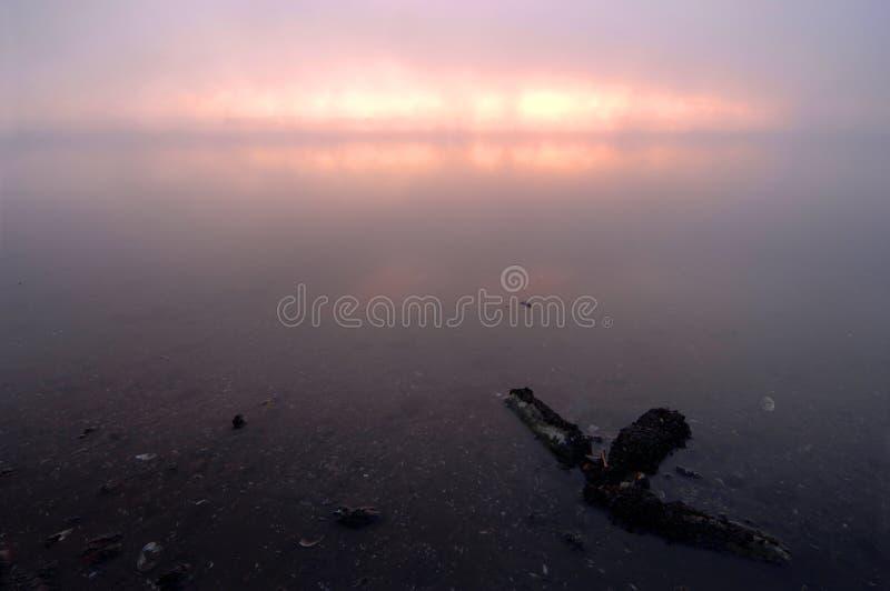 Pink surise on a misty river stock photo