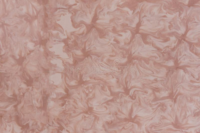 Pink swirling cream marble texture stock image