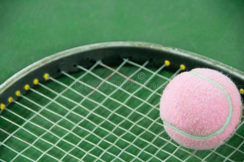 Pink Tennis Ball On A Racket Stock Photo - Image: 29559328