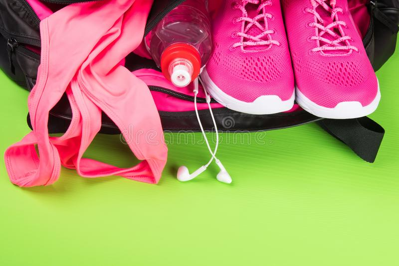 Pink things for playing sports on a green background stock images