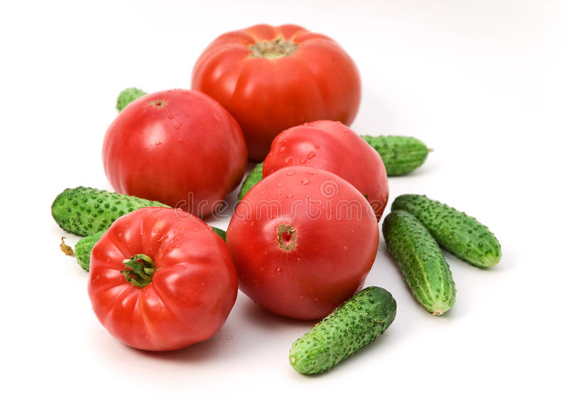 Pink Tomatoes and Cucumbers stock images