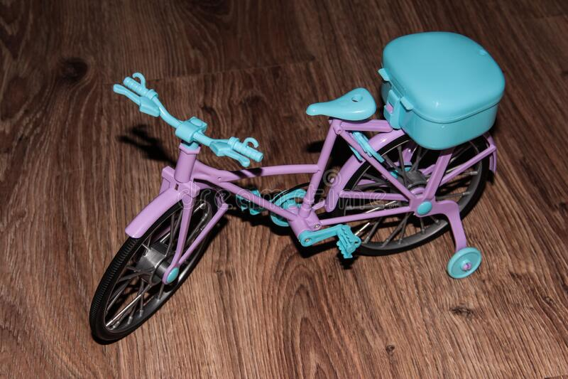Pink toy bike. Pink and blue transport for dolls.  stock photography