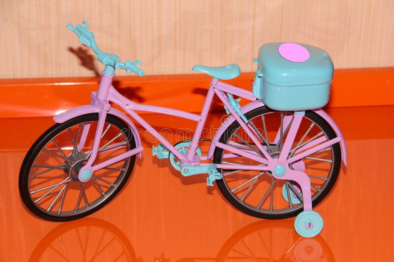 Pink toy bike. Pink and blue transport for dolls.  royalty free stock images