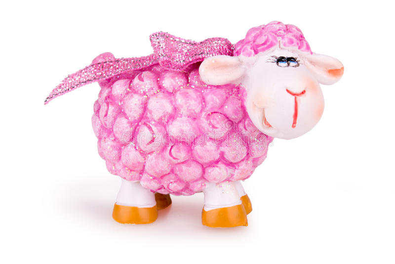 Pink toy sheep. Festive pink toy sheep on white background royalty free stock images