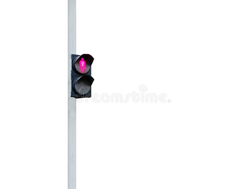 Traffic light depicting a woman in pink with a sign of feminism. royalty free stock image