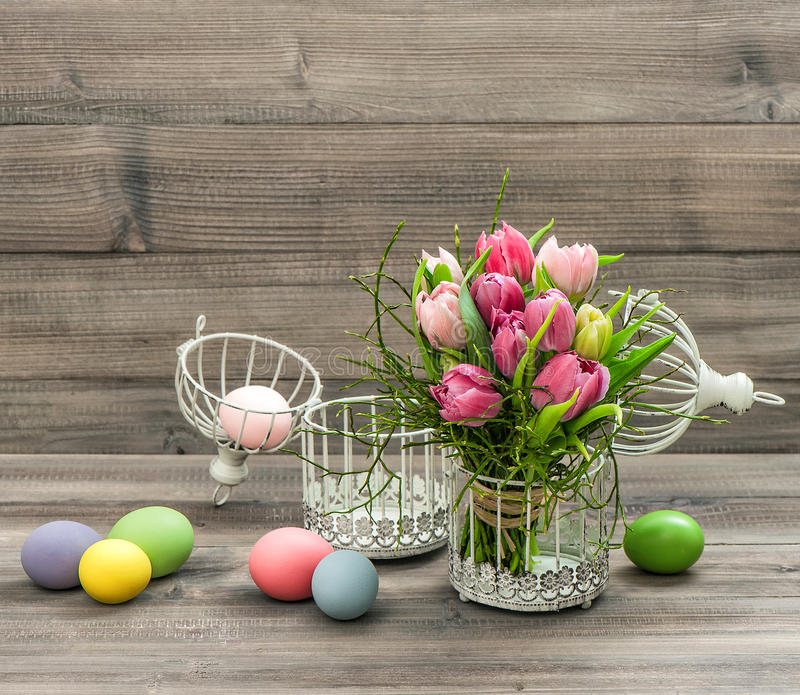 Pink tulip flowers and colored easter eggs. Retro style picture stock photos