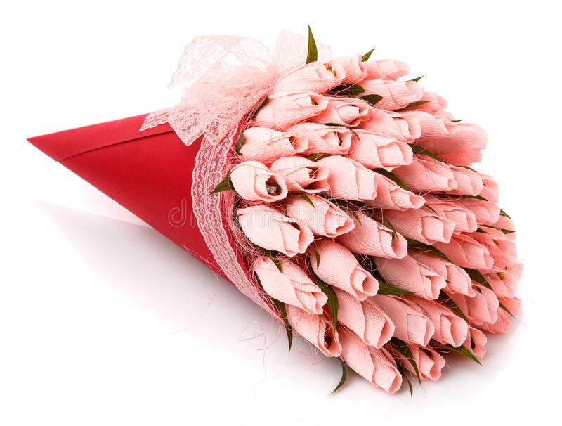 Pink tulips with candy inside made of corrugated paper in a red wrap with lace on a white background stock photos